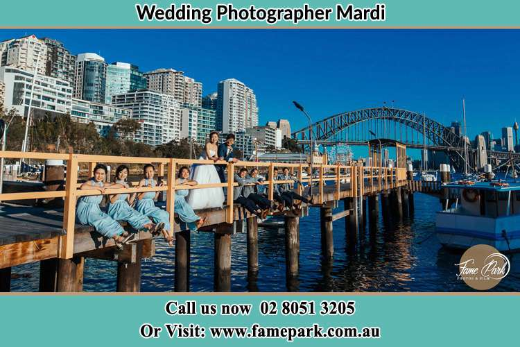 Photo of the Groom and the Bride with the entourage at the bridge Mardi NSW 2259
