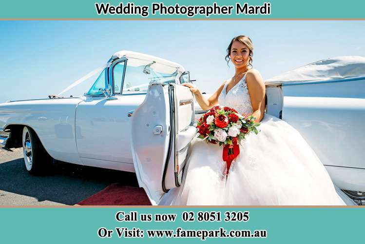 Photo of the Bride outside the bridal car Mardi NSW 2259