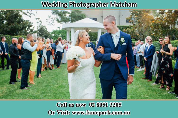 Photo of the Bride and the Groom looking each other while walking Matcham NSW 2250