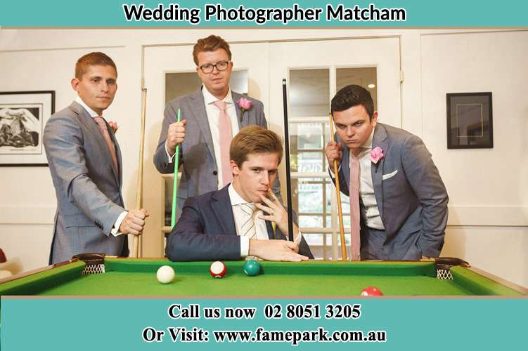 Photo of the Groom and the groomsmen playing billiard Matcham NSW 2250