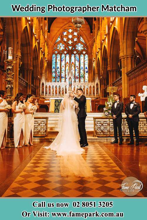 Photo of the Groom and the Bride with the entourage at the altar Matcham NSW 2250