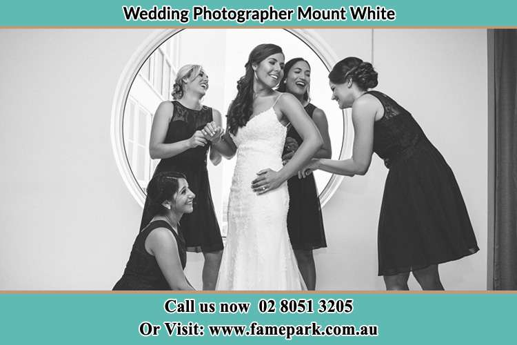 Photo of the Bride and the bridesmaids near the window Mount White NSW 2250