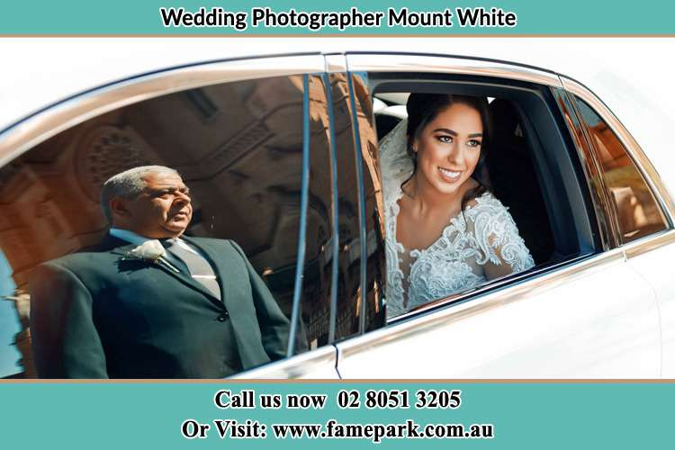 Photo of the Bride inside the bridal car with her father standing outside Mount White NSW 2250