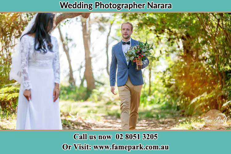 Photo of the Groom bringing flower to the Bride Narara NSW 2250