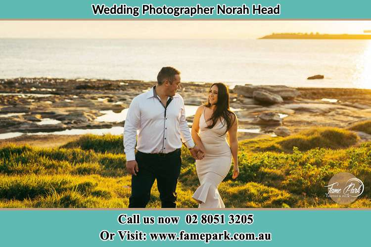 Photo of the Groom and the Bride walking near the lake Norah Head NSW 2263