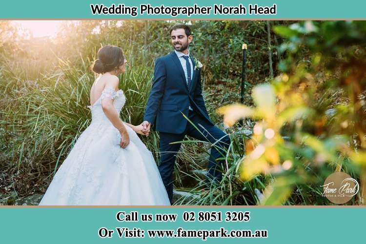 Photo of the Bride and the Groom going up the hill Norah Head NSW 2263