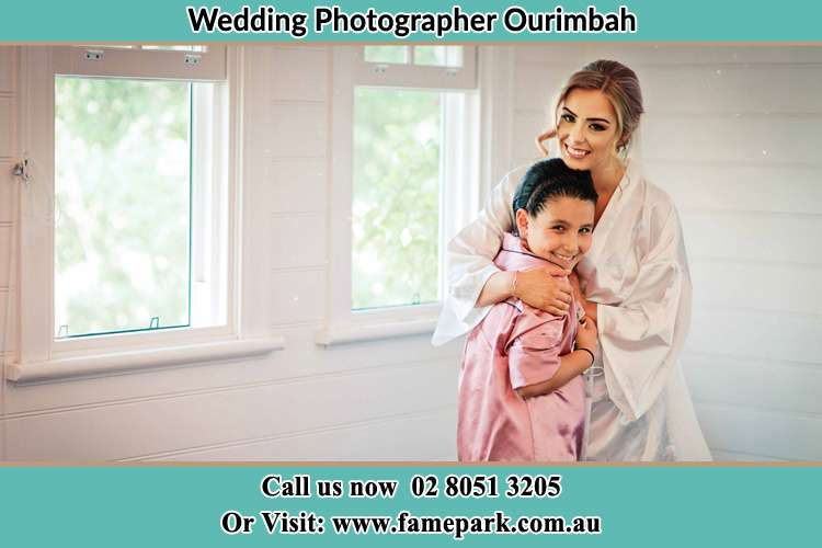 Photo of the Bride hugging the flower girl Ourimbah NSW 2258