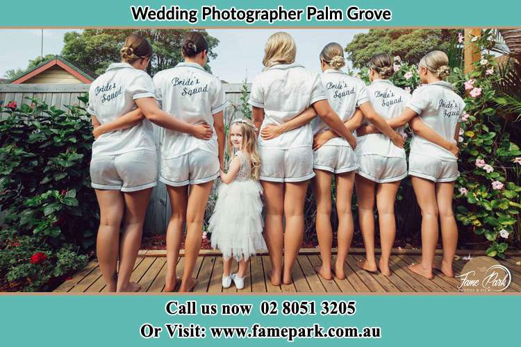 Behind photo of the Bride and the bridesmaids with the flower girl looking back Palm Grove NSW 2258