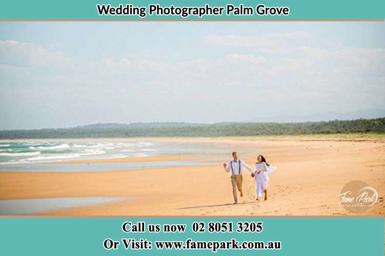 Photo of the Groom and the Bride walking at the sea shore Palm Grove NSW 2258