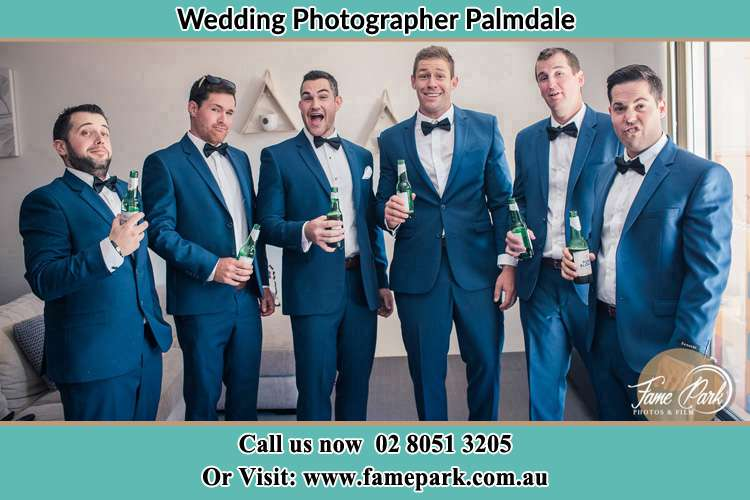 The groom and his groomsmen striking a wacky pose in front of the camera Palmdale NSW 2258