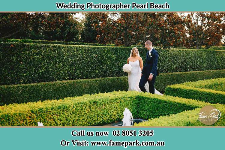 Photo of the Bride and the Groom walking at the garden Pearl Beach NSW 2256