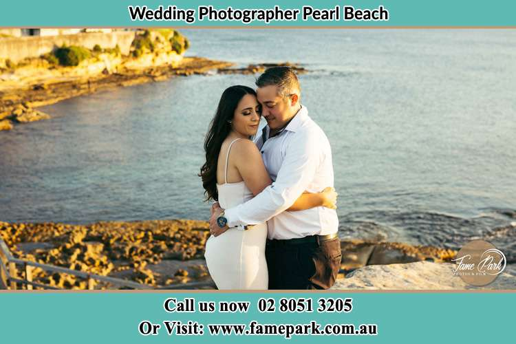 Photo of the Bride and the Groom hugging near the lake Pearl Beach NSW 2256