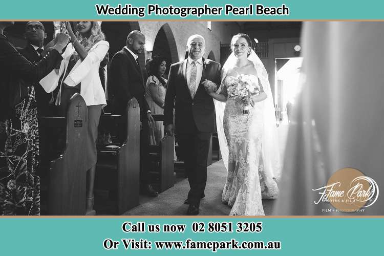 Photo of the Bride with her father walking the aisle Pearl Beach NSW 2256