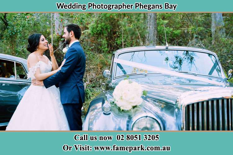 Photo of the Bride and the Groom besides the bridal car Phegans Bay NSW 2256