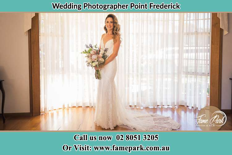 Photo of the Bride holding flower bouquet Point Frederick NSW 2250
