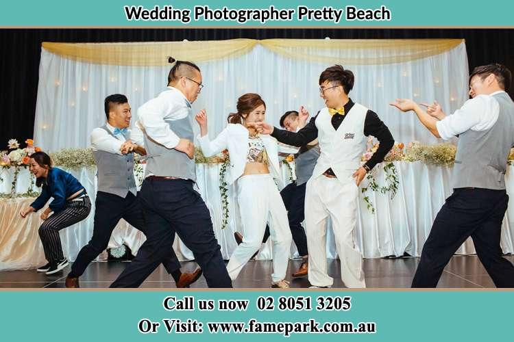 Photo of the Groom and the Bride dancing with the groomsmen on the dance floor Pretty Beach NSW 2257