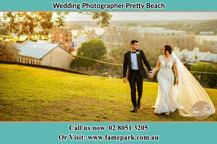 Photo of the Groom and the Bride walking at the yard Pretty Beach NSW 2257