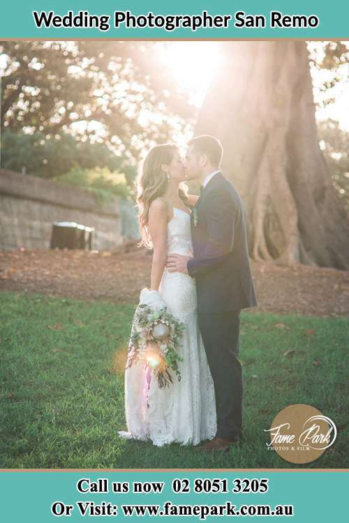Photo of the Bride and the Groom Kissing at the yard San Remo NSW 2262