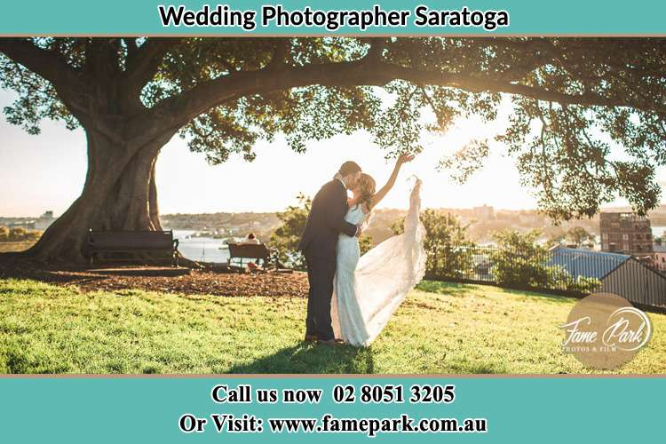 Photo of the Groom and the Bride kissing under the tree Somersby NSW 2250