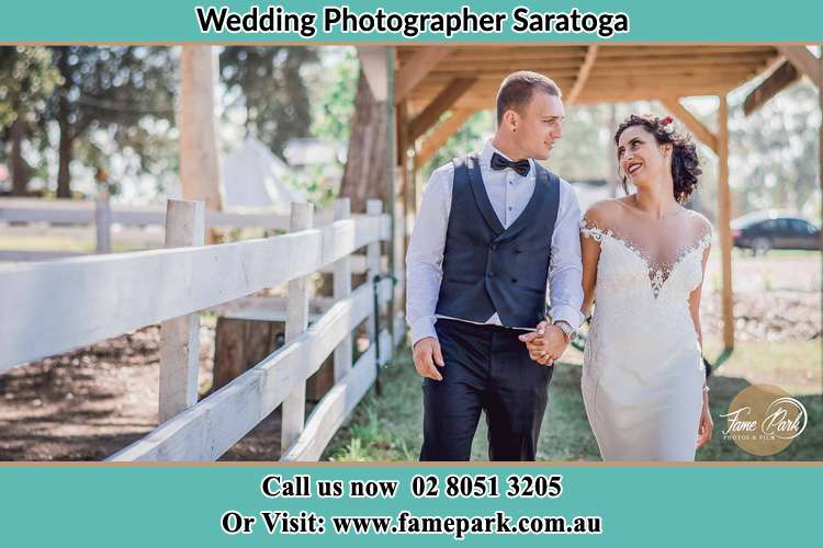 Photo of the Groom and the Bride holding hands while walking Somersby NSW 2250