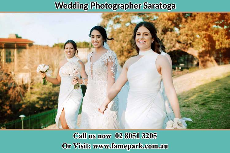 Photo of the Bride and the bridesmaids walking Saratoga NSW 2251