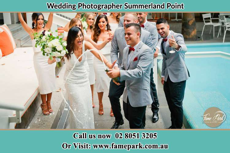 Photo of the Bride and the Groom celebrating with the secondary sponsors Summerland Point NSW 2259