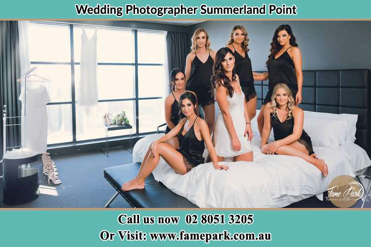 Photo of the Bride and the bridesmaids wearing lingerie on bed Summerland Point NSW 2259