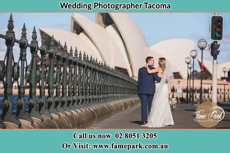 The Bride and the Groom with their entourage pose for the camera Tacoma NSW 2259