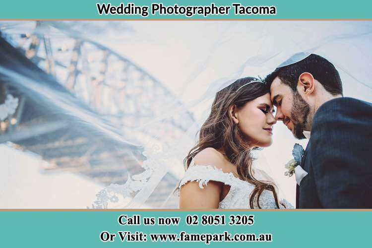 Close up photo of the Bride and the Groom under the bridge Tacoma NSW 2259
