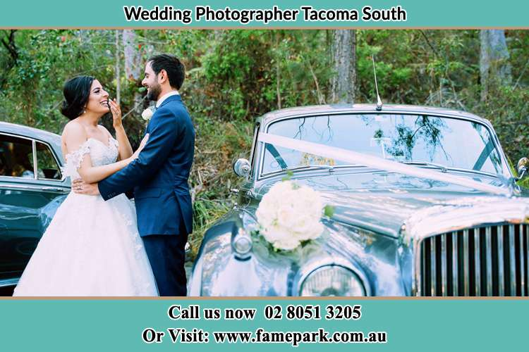 Photo of the Bride and the Groom near the bridal car Tacoma South NSW 2259