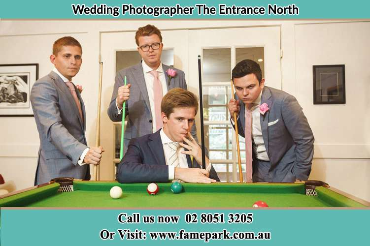Photo of the Groom and the groomsmen playing billiard The Entrance North NSW 2261
