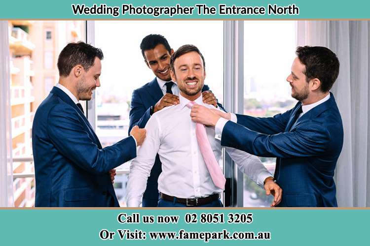 Photo of the Groom helping by the groomsmen getting ready The Entrance North NSW 2261