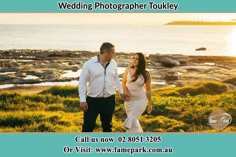 Photo of the Groom and the Bride walking near the lake Toukley NSW 2263