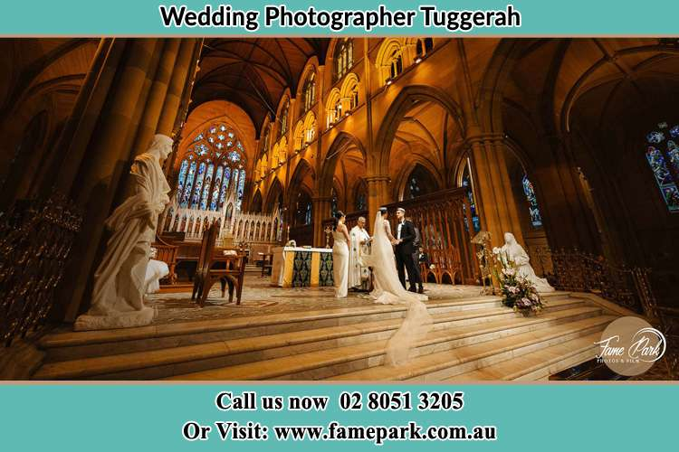 Photo of the Bride and the Groom at the altar Tuggerah NSW 2259