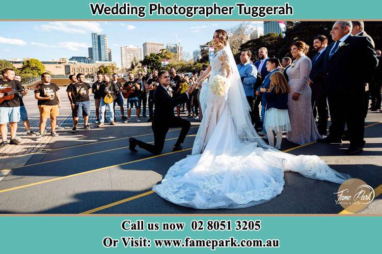 Groom Kneeling down in front of the Bride Tuggerah NSW 2259