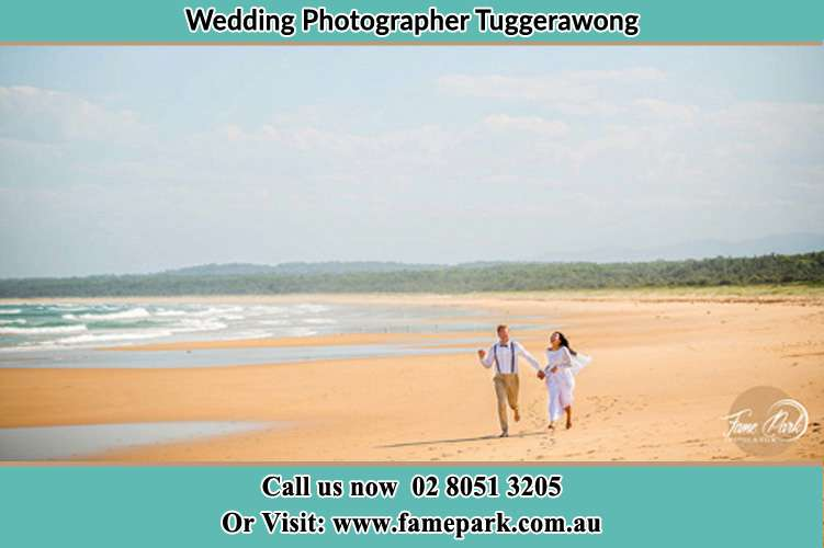 Photo of the Groom and the Bride walking at the sea shore Tuggerawong NSW 2259
