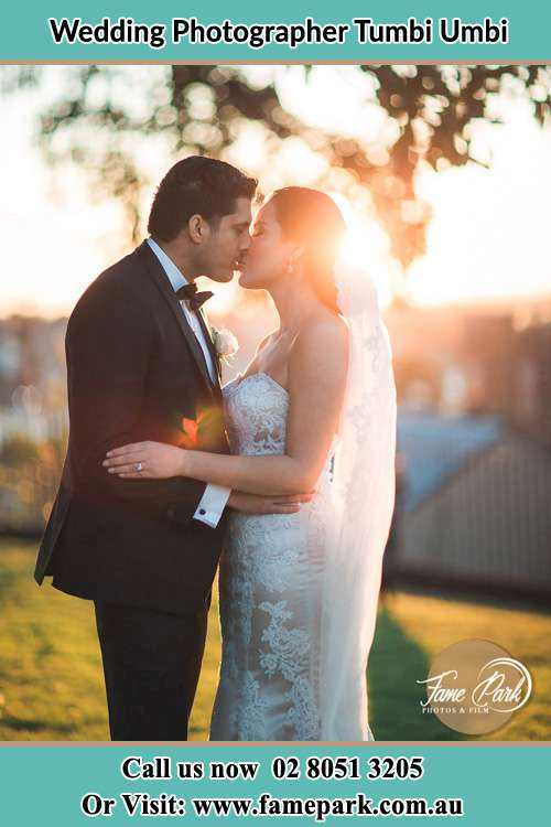 Photo of the Groom and the Bride kissing at the yard Tumbi Umbi NSW 2261