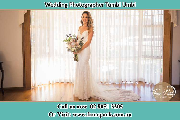 Photo of the Bride holding flower bouquet Tumbi Umbi NSW 2261