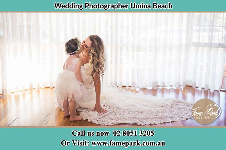 Photo of the Bride kiss the flower girl Umina Beach NSW 2257