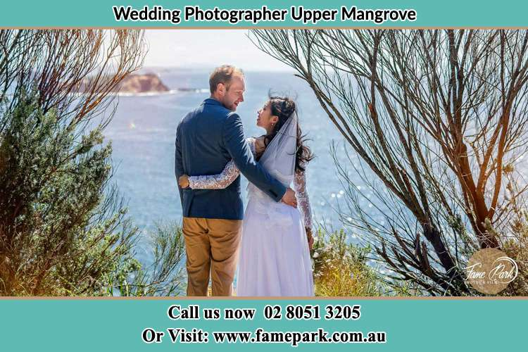 Photo of the Groom and the Bride looking each other near the sea front Upper Mangrove NSW 2250