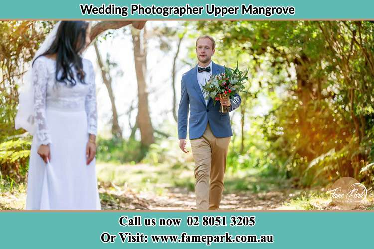 Photo of the Groom bringing flower to the Bride Upper Mangrove NSW 2250