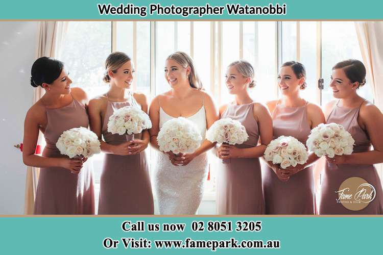 Photo of the Bride and the bridesmaids holding flower bouquet Watanobbi NSW 2259