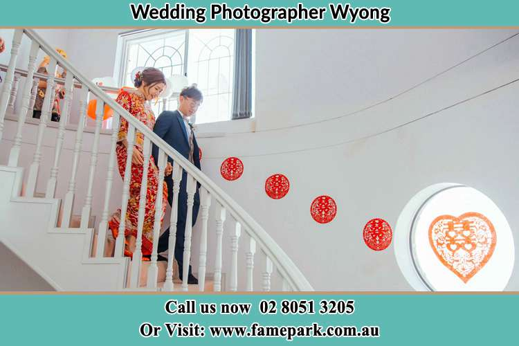 Photo of the Bride and the Groom going down the stair Wyong NSW 2259
